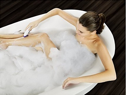 Woman using Braun Silk-épil 9 9-579 Wet and Dry Cordless electric hair removal epilator.